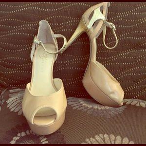 Nude open toed heels.