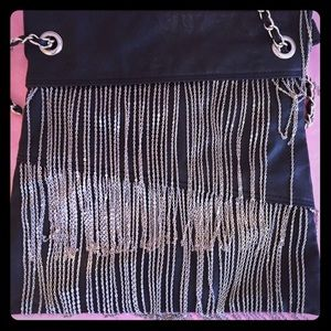 Black shoulder bag with silver chain detail