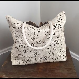 Anthropologie Handbags - Anthropologie Buco laser cut lace leather bag