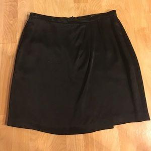 Dresses & Skirts - Sexy silky black pleated skirt w/ pockets