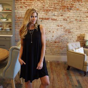 Dresses & Skirts - ✨RESTOCKED✨Black sleeveless swing dress w/ pockets