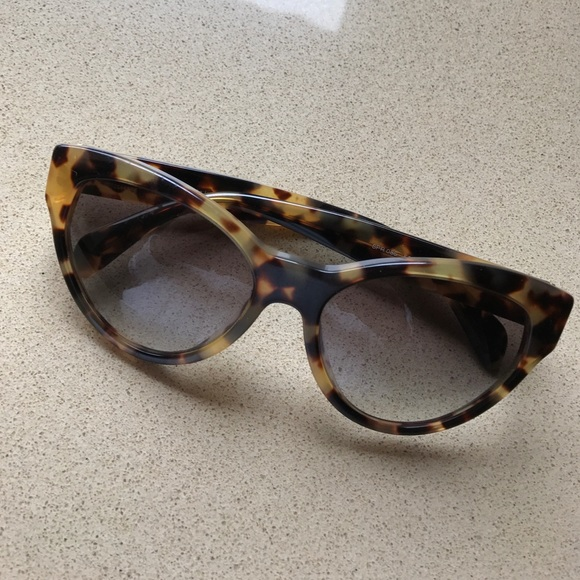 a3363830c Prada tortoise shell cat eye sunglasses. M_5894fe205a49d087fc00285c