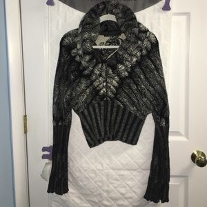 Roberto Cavali sweater can fit several sizes