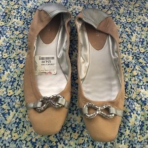 9 West Taupe flats with silver ornament on front