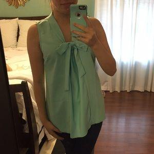 ModCloth Tops - Miami Moments sleeveless tie-neck blouse. NWOT