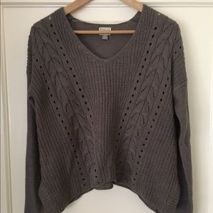 Loose fitting, light brown sweater