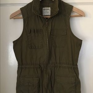 Olive green, sleeveless vest