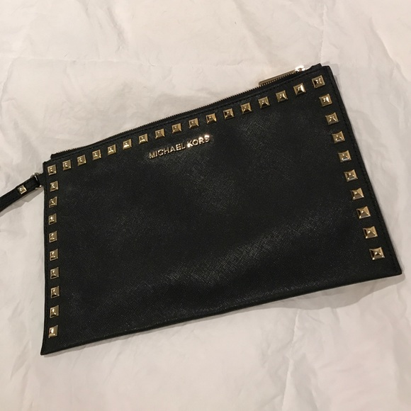 476fe1b03e8b83 MICHAEL KORS Stud Saffiano Leather Black Clutch. M_5896a35a5a49d0ea0f05fc56