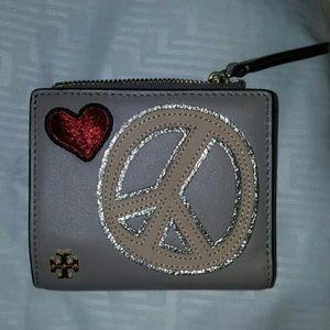 Tory Burch Handbags - TORY BURCH Peace Mini Wallet in Tan