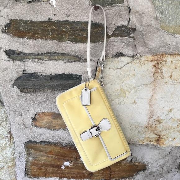 Coach yellow w/ white leather piping wristlet
