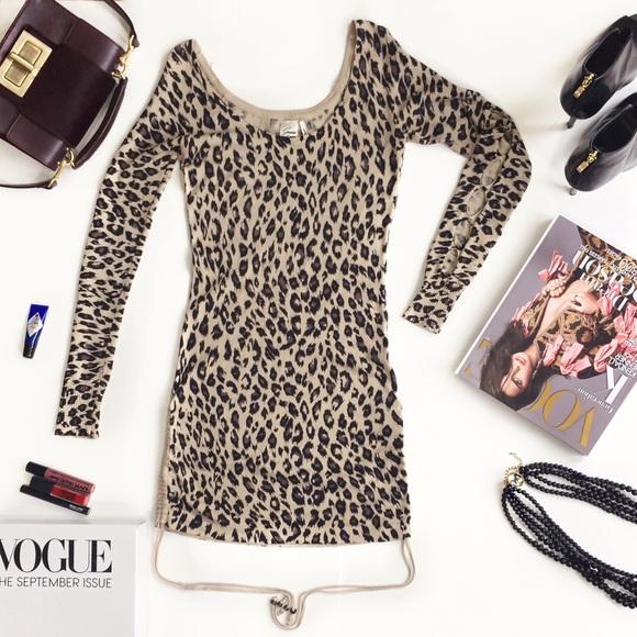05b546f6f1 Guess Dresses   Skirts - GUESS Animal Print Mini Sweater Dress.