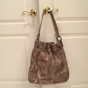 Donald Pliner gold hand bag never worn
