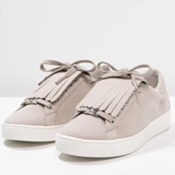 1d9b4378849 Michael Kors keaton kiltie fringe sneakers
