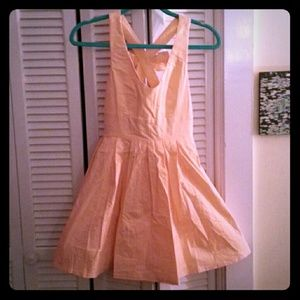 Peach sundress with a bow in the back!