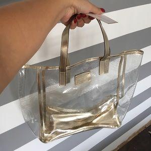 6cf86a05541d Michael Kors Bags - Michael kors clear and gold travel tote /beachbag