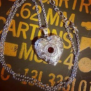 Jewelry - Bullet casing heart locket 357 garnet