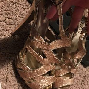 Gold criss cross heels