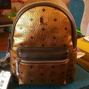 MCM Handbags - MCM Small Gold Exclusive Backpack