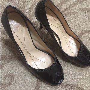 Kate Spade black patent open reel heel.. size 10