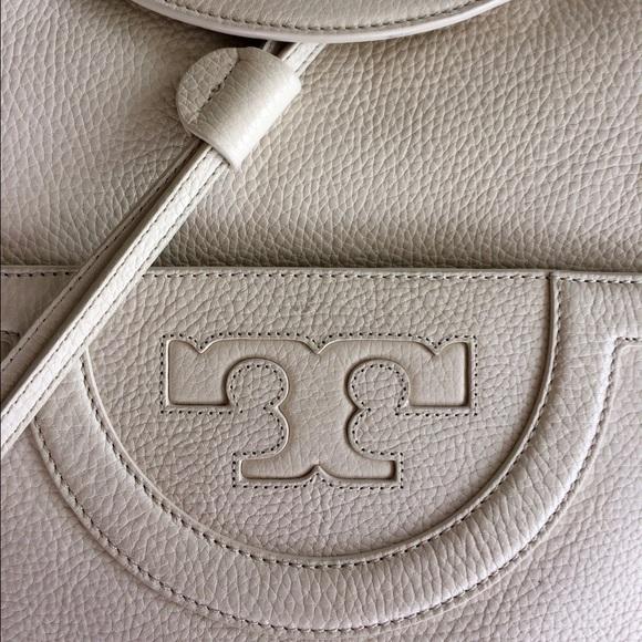 eb363dfbed3b Tory Burch Serif T Backpack in New Ivory. M 589e18e2bf6df5ffac0125e8
