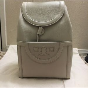 11ab2bc86099 Tory Burch Bags - Tory Burch Serif T Backpack in New Ivory