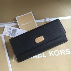 Michael Kors Handbags - 🍥MK flap black Saffiano wallet
