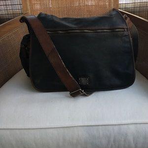 Cole Haan men's leather messenger bag.