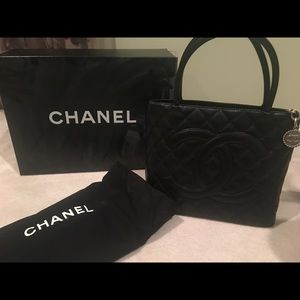 Handbags - Chanel madellion black caviar bag.