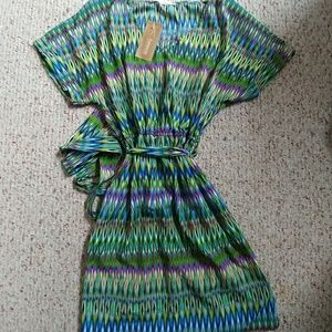 NWT. Francesca's Multi-colored dress with pockets!
