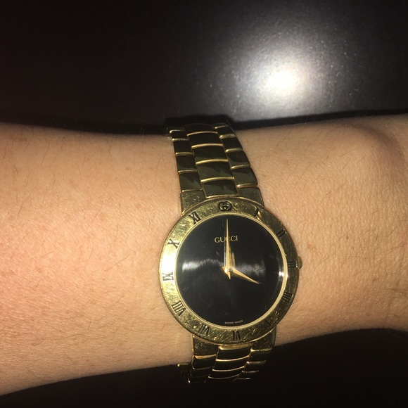 a68cb309f25 Gucci Jewelry - Vintage gold and black Gucci watch
