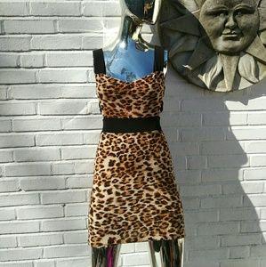 zinga Dresses & Skirts - Zinga leopard print open back tight mini dress