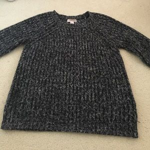 Long sleeved black and white marbled knit sweater