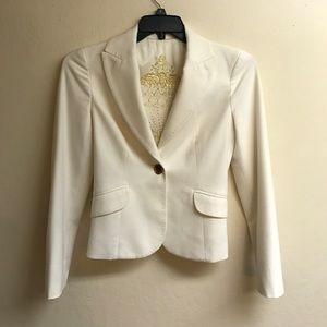 Ivory Bebe blazer, soft on the outside.