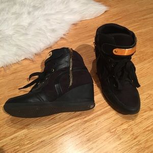 Black and gold trainer wedges
