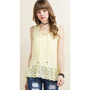 Lemon yellow eyelet lace up sleeveless top