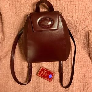Cartier Handbags - Cartier Burgundy Leather Mini Backpack 🎒