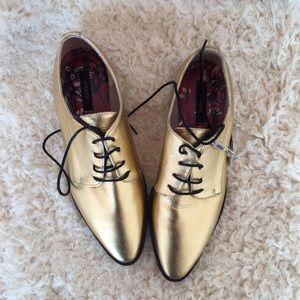 Golden Oxford shoes by Uterqüe (Zara Luxury)
