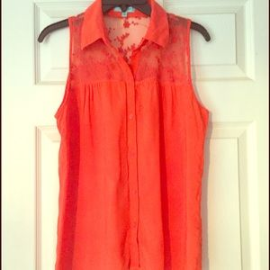Orange sleeveless blouse.