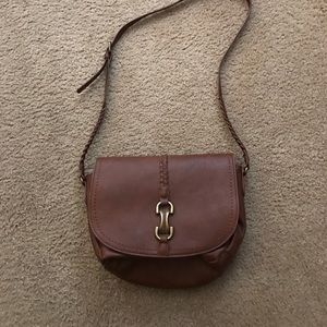 Brown cross body purse.