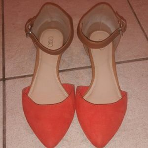 Orange and brown pointed toe flats