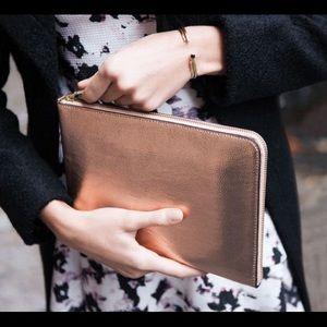 Ivanka Trump Handbags - Ivanka Trump Cell tablet clutch w chrgr & bat pk