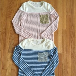 Pink or blue striped sweater tops