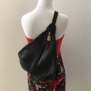 Tignanello Handbags - Tignanello one strap triangular backpack