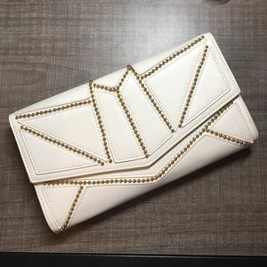 Nila Anthony Handbags - White faux leather clutch with gold accents