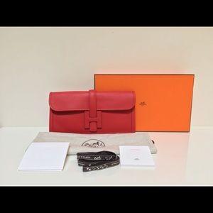 Hermes Handbags - Hermes Classic H Red 29 Swift Clutch Bag