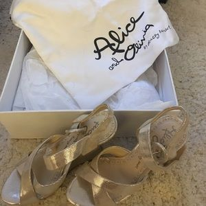 Alice and olivia gold wedges
