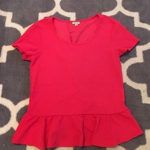 Coral peplum top with ruffle back