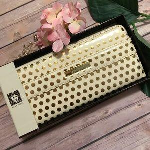 Anne Klein Handbags - ⚡️SALE⚡️Anne Klein gold and white polka dot wallet
