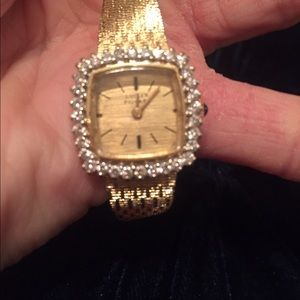 Lucien Piccard Jewelry - 14k gold watch with diamond bezel.