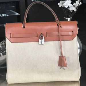 Hermes Handbags - 100% AUTH HERMES CANVAS/LEATHER CONVERTIBLE BAG